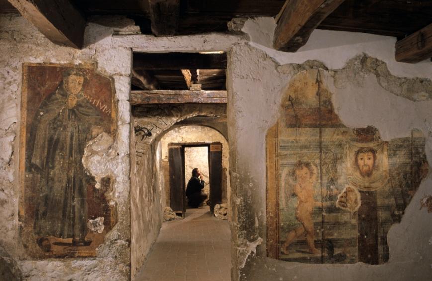 Camino-10455, St. Francis, Camino, Italy, ITALY-10480. A fry prays.
