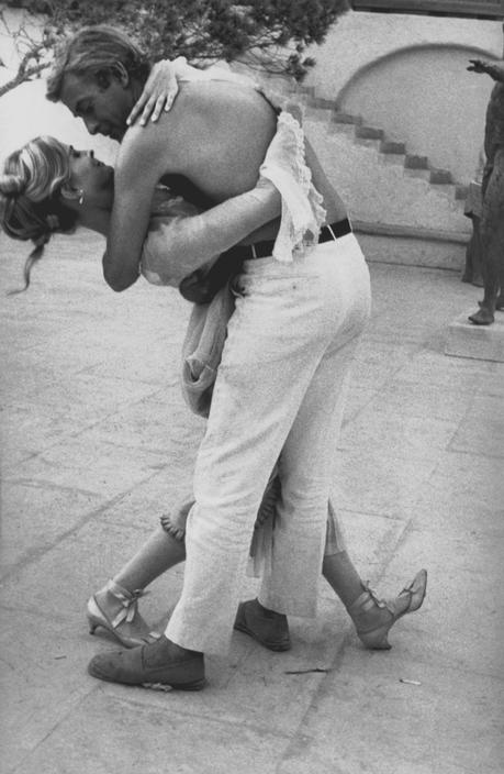 Eve Arnold SPAIN. Mallorca. Candice BERGEN and Michael CAINE try out a tango to pass the time. 1967