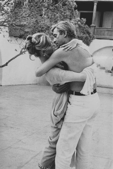 Eve Arnold SPAIN. Mallorca. More fooling arround. Candice BERGEN and Michael CAINE try out a tango to pass the time. 1967